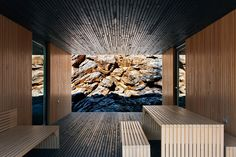 wood on wood on rock, cliff, mountain side, lines, parallel, nature inside, interior, Bères Architects, in Hungary, scandinavian retreat.