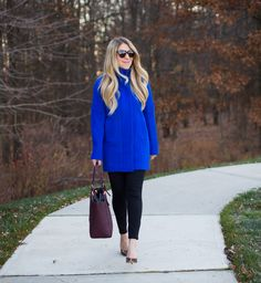 A bright blue JCrew Factory City Coat is reviewed. Here, it is paired with black ponte skinny pants and the Tory Burch York Tote.