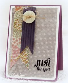 BG+-+CAS.jpg (426×518)I used a purple card base and layered some white card onto it. Then I used Basic Grey Plumeria 6x6 papers for the background papers and the pennants. The sentiment is from Waltzingmouse Stamps' Compact Sentiments.