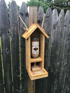 Our rustic bird feeder is handmade from recycled pallets and bottles with attached sturdy rope for hanging. We also include a small plastic funnel to assist with pouring the seeds into the bottle which can get messy if you dont have one. There is also a removable piece of wood that comes with the