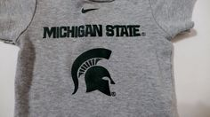 Is Michigan State you favorite #NCAA school? You'll want this Nike one piece for your baby boy or girl to cheer your Spartans to victory!