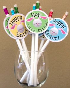 """Enjoy these FREE Spring graphic designs. Hop into Spring with these printable' versatile tags. Print on sticker paper to make Spring and Easter stickers or labels. Print on card stock and trim to make cupcake toppers or pencil toppers. The tags include the words, """"Hop Into Spring"""" and """"Hoppy Easter""""."""
