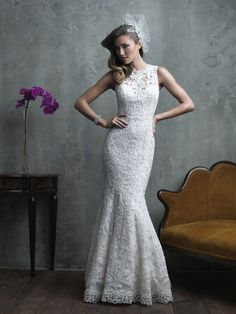 This oh-so-softly tapered gown is slim fitting and gorgeously embroidered with exotic, symmetrical lace and intricate beading. C311 SIZES 2-32, COLORS: WHITE, IVORY, GOLD/IVORY