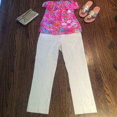 Lilly Pulitzer Resort White Ankle/ Cropped Pants Super sexy fitted Lilly Pulitzer white ankle pants. Wore once on vaca had dry cleaned and stored away. The length from top pant to bottom measures 30 inches. Basically brand new without tags. Faux slit pockets. Lilly Pulitzer tube top is listed in my closet. Shoes and purse are not for sale. Size 2. For reference I am 5'3. Please review all pictures. No Trades. Lilly Pulitzer Pants Ankle & Cropped
