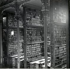 """In the age of electronic information, it's easy to forget that the great libraries of the past were overwhelming storehouses of information.  This fascinating picture from the Cincinnati Public Library was taken in the 1870s in the """"Main Hall.""""  Widely believed to be the most impressive public library in the country during the 19th century, it sported five tiers of alcoves for shelving, with narrow walkways between them.  Sadly, the building was torn down in 1955."""
