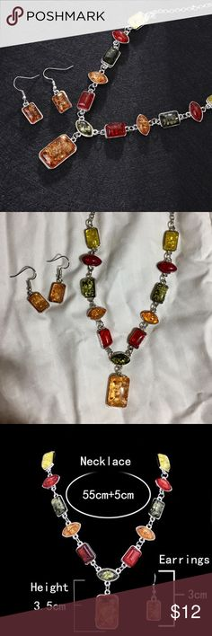 Silvertone and Amber Necklace & Earring Set Silver Necklace and Earring set with faux amber stones and other Coordinating faux stone pieces. These are surprisingly lovely pieces of costume jewelry! Jewelry