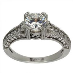 Art Deco Diamond Engagement Ring With Pave Diamonds 0.55ctw 14K White Gold  Setting Only: $1,150.00 (without center stone)  Special order in 18K white or yellow gold or Platinum.  This art deco ring is set with a 1ct round certified diamond. Our 1ct diamonds range from $2,400.00 up to $6,000.00 depending on quality & uncertified diamonds start at a lower price. We have 5,000 diamonds of various sizes, shapes and qualities to choose from and only use natural earth mined untreated diamonds…