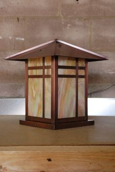 Copper and iridized glass mission post lantern by Lightcrafters in Austin, TX