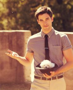 Don't know who this is, but he's hot and has a cute dog. We both need to take that extended hand and run, Laura. Hahaha