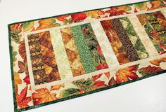 Fall Leaves Table Runner Quilt, Orange, Green, Brown with Gold Highlights, Quilted Table Runner, Autumn Quilt, Quiltsy Handmade by QuiltSewPieceful on Etsy