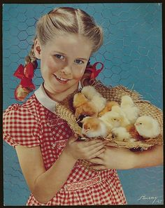 Such a sweet, cheerful, timelessly cute image from 1947 of a girl holding a basket of spring  chicks