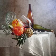 """Grapefruits Pineapple and a Glass of Red Wine - <a href=""""http://nikoartstilllife.tumblr.com/post/155954287195/grapefruits-pineapple-and-a-glass-of-red"""">framed version...</a>  Fruit still life photography with yellow and red pomegranates, pineapple, glass of red wine and green bottle in disarray on white tablecloth in interior decoration"""