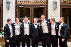 Champagne suit and bowtie groomsmen