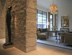 peeking around the corner into the room gives some clues ... natural stone, lots of light