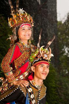 Taiwan | A Rukai Aboriginal groom carries his bride on his back at a traditional wedding. | ©Rich J Matheson