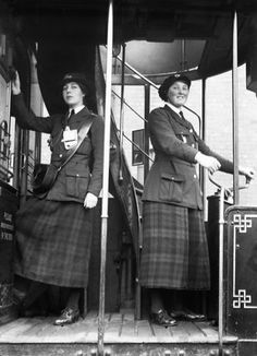 A female tram driver and conductor of the Glasgow Corporation in 1918.  Lewis G P  © IWM (Q 28389)