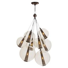 Create a dazzling focal point in your foyer, living room, or dining room with this captivating steel and glass chandelier, showcasing a cluster of clear orb ...