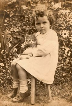 Vintage Photograph - Young girl and her cat