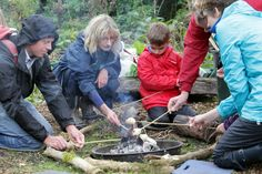 Cooking damper bread over the fire. Photograph by Ric Mellis