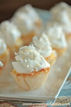 Mini Coconut Cream Pies Recipe ~ All the flavor of the traditional Coconut Cream Pie, made in pre-made phyllo dough cups for quick preparation. Perfect for parties.