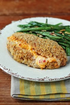 This Pimento Cheese Stuffed Chicken has a crispy Cajun panko coating and warm, gooey pimento cheese inside! Totally decadent but only 344 calories or 9 Weight Watchers SmartPoints! www.emilybites.com