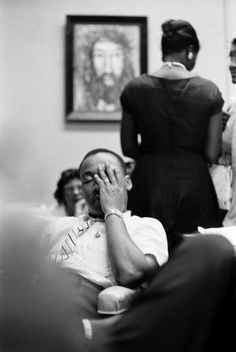A weary King inside Rev. Ralph Abernathy's First Baptist Church in Montgomery, Alabama, on May 21, 1961. Those gathered at First Baptist that night kept one ear tuned to the encouraging words of their religious leaders and another to the thousands of angry whites gathering outside. Sometime during these long, tense hours, King had a phone conversation with Robert F. Kennedy, and blasted the U.S. attorney general for allowing the untenable situation to fester.