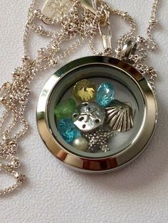 Beach theme Origami Owl locket Tell your story with an Origami Owl living locket Like it, place an order. Love it, host a show...Want it all, join my team! #54057 origamicharms@gmail.com https://www.facebook.com/pages/Origami-Owl-Paula-Hinson-Independent-Designer/419326878190030?ref=hl