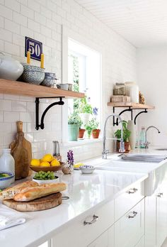 This classic white cottage kitchen features subway tile and open shelving, and is designed to facilitate indoor-outdoor flow for dinner prep and alfresco dining. Kitchen Dinning, New Kitchen, Kitchen Tiles, Kitchen Shelves, Wood Shelves, Kitchen Counters, Country Kitchen, Industrial Shelves, White Counters
