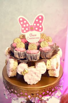 Pink and Gold Minnie Mouse rice krispie treats and mini cheesecake bites.