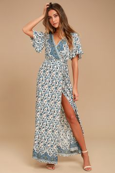 Your yacht awaits in the Amabella Cream Print Wrap Maxi Dress! A short sleeve floral print wrap maxi dress.