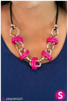 Fiercely Fearless ngling from two strands of black suede, playful pink ovals wrap around bold gold chain-links creating a fearless design. Features an adjustable claps closure.  Sold as one individual necklace. Includes one pair of matching earrings.