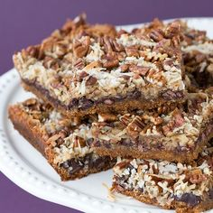 Vegan Cookies book Magical Coconut Cookie Bars  One 14 oz can (regular or lite) coconut milk (about 1 3/4 cups)  2/3 cup dark brown sugar  2 cups vegan graham cracker crumbs  1/2 cup melted margarine  2 tablespoons sugar  1 1/2 cups chocolate chips or chocolate chunks  2 cups flaked, sweetened coconut  1 cup walnuts or pecans, choppe