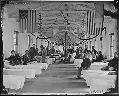 Wounded soldiers recover in a Civil War hospital in the early 1860s.