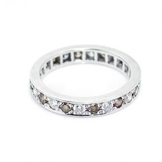 Infinity wedding band by Larissa Landinez is a classical but distinguished wedding band with white and cognac diamonds