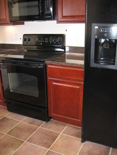 Kitchen Color Scheme with Black Appliance. Kitchen Color Scheme with Black Appliance. Gray Kitchen Cabinets with Black Appliances In Kitchen Tuscan Kitchen, Appliances, Replacing Kitchen Countertops, Modern Kitchen Cabinets, Kitchen Countertops, Kitchen Colour Schemes, Trending Decor, Kitchen Improvements, Black Appliances Kitchen