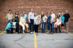 Not sure I like a brick wall background . Too much ugly parking lot. Do we need things to sit on? We have long bench on front porch for people Large Family, Extended Family, Multi-Family, Rose Rock Photography Large Family Portraits, Extended Family Photography, Large Family Photos, Family Posing, Family Pictures, Family Photo Colors, Navy Blue Walls, Children Photography, Photography Ideas