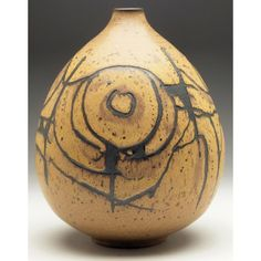 """Good Clyde Burt vase, large bulbous shaped vessel with incised and painted stylized designs in brown and black, signed, 8""""w x 10""""h"""