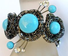 *This is a brand new without tags wide clamper style bracelet. *This is a fabulous bracelet, just fit for a runway! *It has faux turquoise and clear rhinestones. *Please visit my shop to find more fabulous pieces of jewelry.