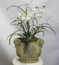 Perfect for any space in your home or office, this orchid arrangement is made to order with beautiful real touch white orchids. Your guests won't believe it's artificial. Plus, it's on sale with FREE shipping!