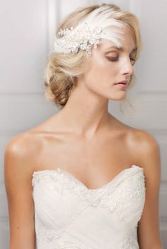 A romantic crystal and feathered bridal headpiece.  Photo Source love my dress  #feathers #crystal #bridalhairaccessories #bridalhair