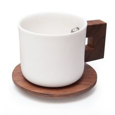 Porcelain Espresso Cups. Attention spans can lag after the main course and last glasses of wine have been served. Grab your guests with these porcelain and black walnut espresso cups—they provide a visual jolt that's as potent as caffeine. $45.00