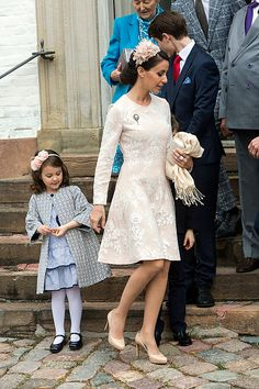 Princess Marie and daughter Princess Athena after Prince Felix' confirmation on April 1, 2017 in Fredensborg, Denmark. Princess Marie wore HUISHAN ZHANG Kiera Cotton Blend Floral Lace Dress.