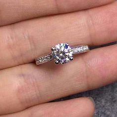 Thin band with a few channel set diamonds on each side with round or square center diamond!