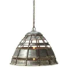 Reminiscent of medieval iconography, a bygone era brought up to warp speed that exhibits fierce presence with tempered silhouettes in a distinctive patina for the dome-shaped colossal pendant lamp. Dappled-finish iron slats assembled with hammered rivet nail heads slyly expose the clear tubular bulb with masculine details in a feminine shape. The pendant is hardwired with a ceiling canopy to create a major raw industrial presence for your inner sanctuary.
