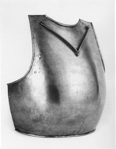 Breastplate, Ruestkammer Schloss Churburg, Schluderns   ref_arm_3810  Date: 1390  Material: Steel (up to 0.6% C)   Hardness: 26 HRC   Heat-Treatment: Air-Cooling  Height: 37 cm  Width: 41 cm  Weight: 2.63 Kg