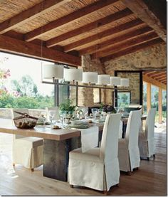 Home Decor; rustic wood and bamboo ceiling of exterior corridor of a Nicaragua house for dinning