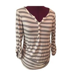 Gray & white striped maternity top 3/4 sleeves. Loose in the belly area. Has the tightness in the sides like all maternity tops. Very very soft material (reminds me of brandy Melville) size medium  perfect condition. From Motherhood Motherhood Maternity Tops