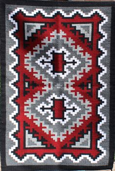 "Navajo handwoven Ganado rug by Kathy Nez. Ganado area rugs are known for their striking ""Ganado red"" color usually contrasted with black, white, and grey elements. Native American Blanket, Native American Rugs, Native American Beadwork, Navajo Weaving, Navajo Rugs, Hand Weaving, Rug Hooking Patterns, Weaving Patterns, Fabric Patterns"