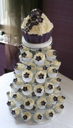 Love the idea of cupcakes rather than a full cake! The top piece if the actual cake for the bride and groom to cut. <3