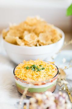Ugly Sweater Holiday Party and An Easy 7-Layer Dip   Dip Recipes   7-Layer Dip Recipe   How to Make a 7-Layer Dip   Party Food Ideas   Holiday Party Ideas   Party Ideas for the Holidays   Fun Party Ideas   Holiday Party Ideas     glitterinc.com   @glitterinc